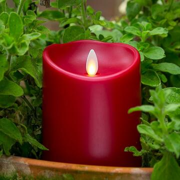 red plastic luminara candle