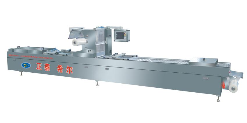 Automatic vacuum forming machine